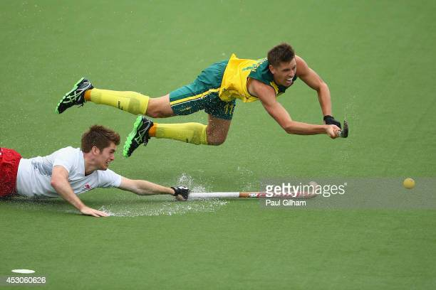 Eddie Ockenden of Australia scores the fourth goal for Australia as Henry Weir of England looks on in the Men's SemiFinal match between Australia and...