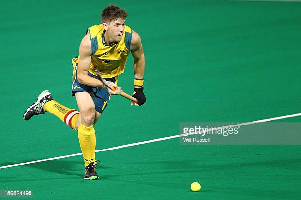 Eddie Ockenden of the Kookaburras hits the ball in the game against Pakistan during day one of the 2012 International Super Series at Perth Hockey...