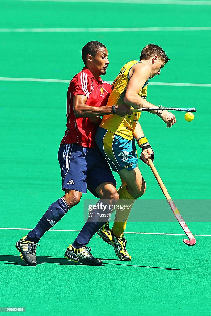 Eddie Ockendenl of the Kookaburras is challenged by Darren Cheesman of England in the Men's Australia Kookaburras v England game during day three of the 2012 International Super Series at Perth International Hockey Arena on November 24, 2012 in Perth, Australia.