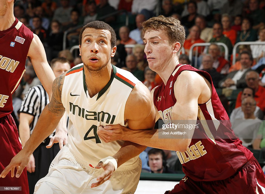Eddie Odio #4 of the Boston College Eagles blocks out Trey McKinney Jones #4 of the Miami Hurricanes during a free throw on February 5, 2013 at the BankUnited Center in Coral Gables, Florida.