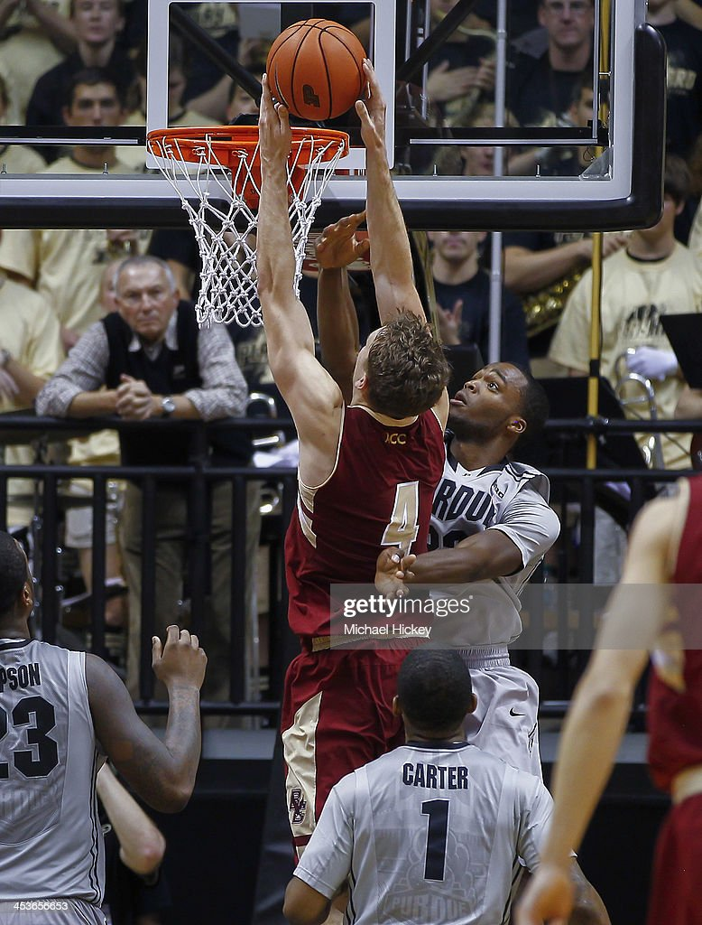 Eddie Odio #4 of the Boston College Eagles goes up to dunk the ball against Errick Peck #32 of the Purdue Boilermakers at Mackey Arena on December 4, 2013 in West Lafayette, Indiana. Purdue defeated Boston College 88-67.
