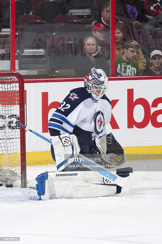 Eddie Pasquale #32 of the Winnipeg Jets makes a save during an NHL game against the Ottawa Senators at Scotiabank Place on March 17, 2013 in Ottawa, Ontario, Canada.