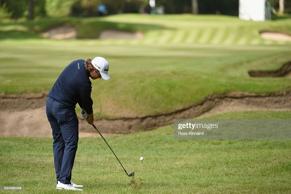 <a gi-track='captionPersonalityLinkClicked' href=/galleries/search?phrase=Eddie+Pepperell&family=editorial&specificpeople=3949697 ng-click='$event.stopPropagation()'>Eddie Pepperell</a> of England hits his 2nd shot on the 12th hole during day one of the BMW PGA Championship at Wentworth on May 26, 2016 in Virginia Water, England.
