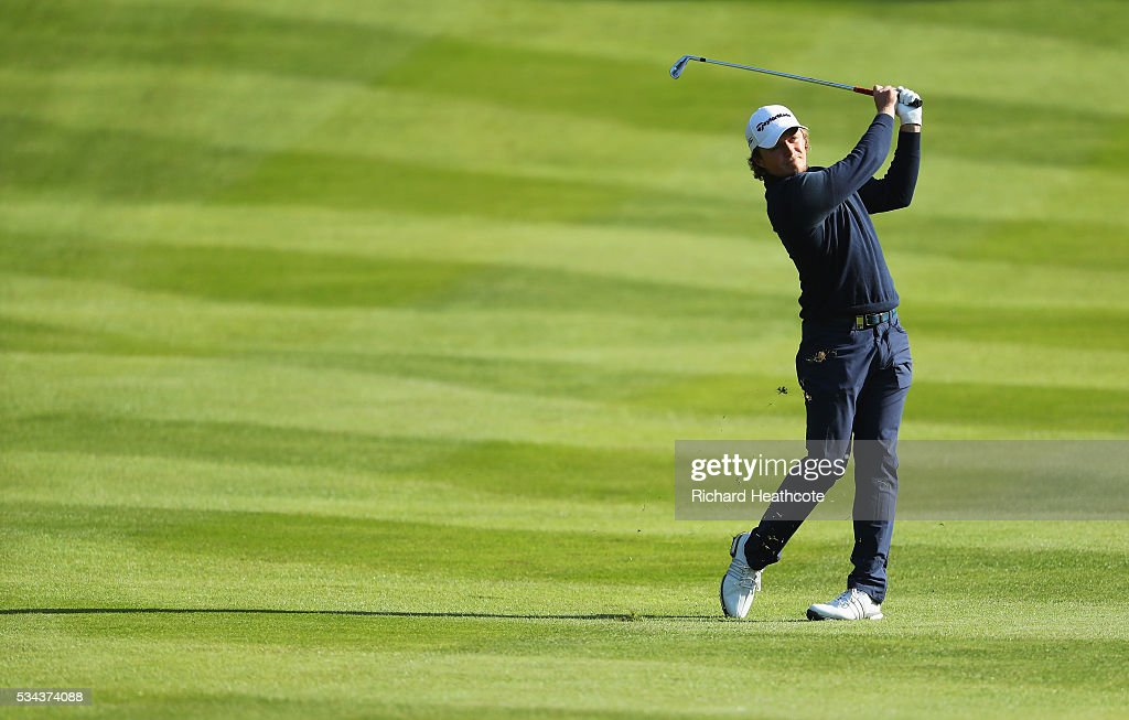 <a gi-track='captionPersonalityLinkClicked' href=/galleries/search?phrase=Eddie+Pepperell&family=editorial&specificpeople=3949697 ng-click='$event.stopPropagation()'>Eddie Pepperell</a> of England hits his approach on the 4th hole during day one of the BMW PGA Championship at Wentworth on May 26, 2016 in Virginia Water, England.