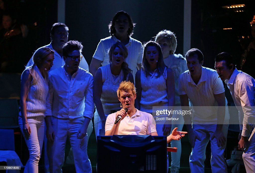 Eddie Perfect who plays Shane Warne sings as he watches television during a 'Shane Warne The Musical' media call at the Arts Centre Melbourne on June 20, 2013 in Melbourne, Australia. Shane Warne The Musical is a musical comedy based on the life of Australian cricketer Shane Warne.