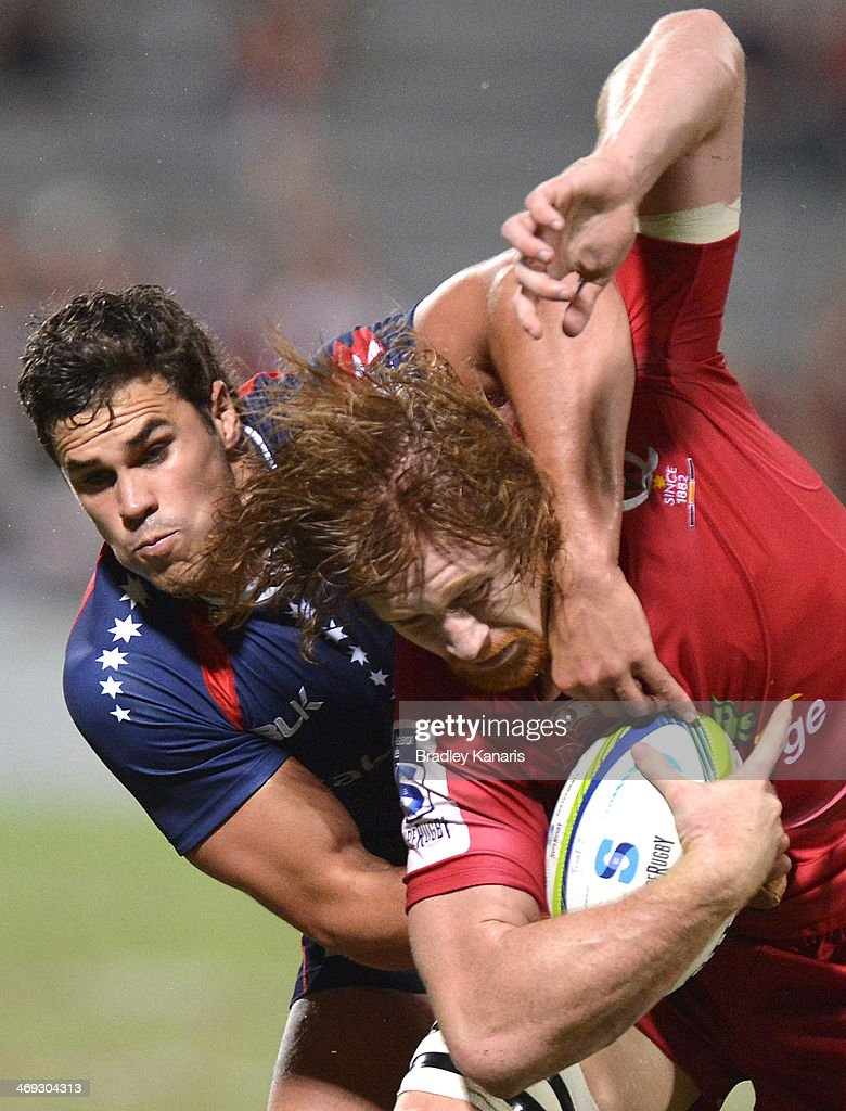 Eddie Quirk of the Reds is tackled during the Super Rugby trial match between the Queensland Reds and the Melbourne Rebels at Ballymore Stadium on February 14, 2014 in Brisbane, Australia.
