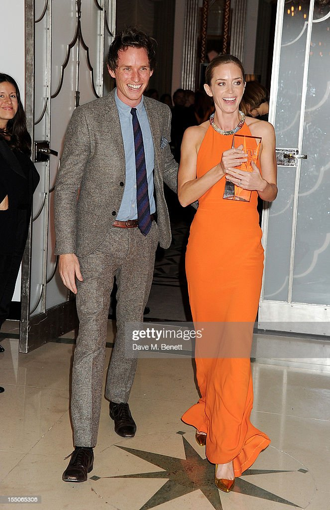 Eddie Redmayne (L) and British Actor of the Year winner Emily Blunt pose at the Harper's Bazaar Women of the Year Awards 2012, in association with Estee Lauder, Harrods and Tiffany & Co., at Claridge's Hotel on October 31, 2012 in London, England.