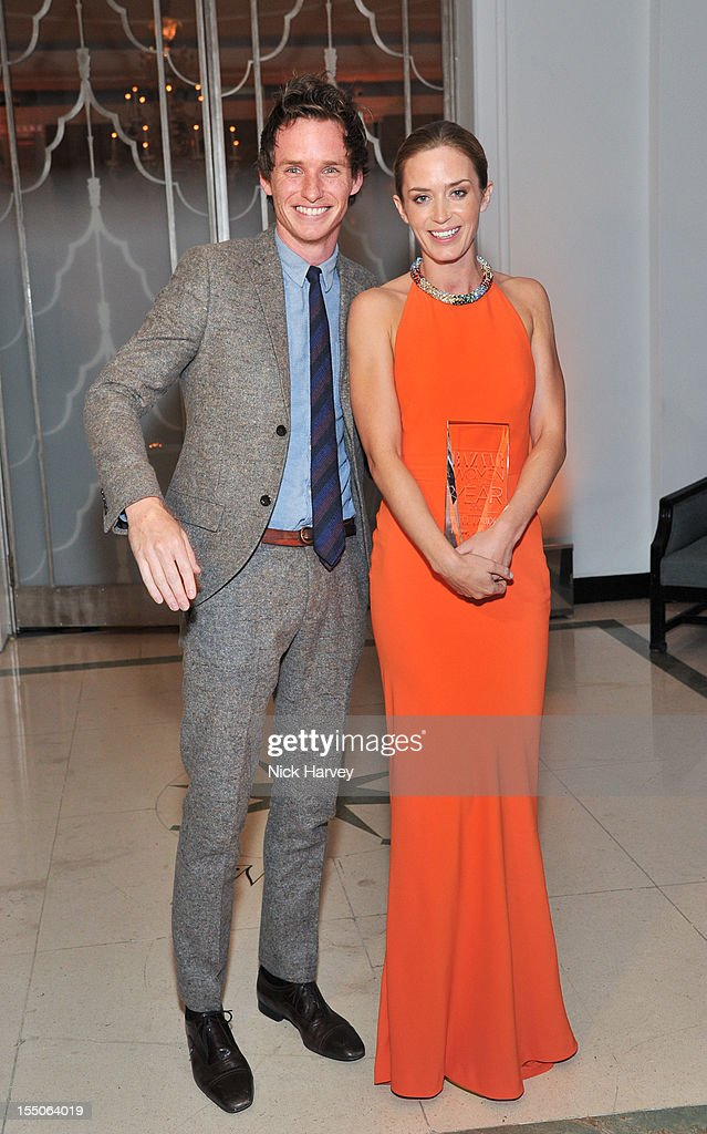 Eddie Redmayne and Emily Blunt attend the Harper's Bazaar Woman of the Year Awards at Claridge's Hotel on October 31, 2012 in London, England.