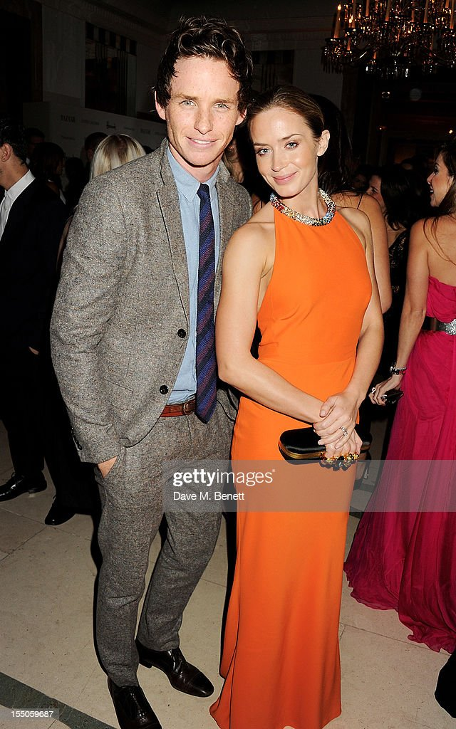 Eddie Redmayne (L) and Emily Blunt attend the Harper's Bazaar Women of the Year Awards 2012, in association with Estee Lauder, Harrods and Tiffany & Co., at Claridge's Hotel on October 31, 2012 in London, England.