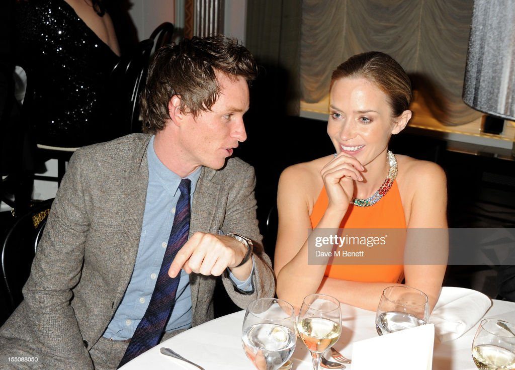 (MANDATORY CREDIT PHOTO BY DAVE M BENETT/GETTY IMAGES REQUIRED) <a gi-track='captionPersonalityLinkClicked' href=/galleries/search?phrase=Eddie+Redmayne&family=editorial&specificpeople=2554844 ng-click='$event.stopPropagation()'>Eddie Redmayne</a> (L) and <a gi-track='captionPersonalityLinkClicked' href=/galleries/search?phrase=Emily+Blunt&family=editorial&specificpeople=213480 ng-click='$event.stopPropagation()'>Emily Blunt</a> attend the Harper's Bazaar Women of the Year Awards 2012, in association with Estee Lauder, Harrods and Tiffany & Co., at Claridge's Hotel on October 31, 2012 in London, England.