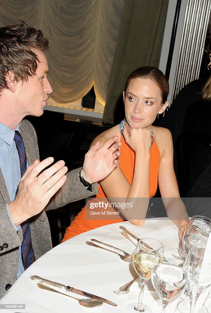 (MANDATORY CREDIT PHOTO BY DAVE M BENETT/GETTY IMAGES REQUIRED) Eddie Redmayne (L) and Emily Blunt attend the Harper's Bazaar Women of the Year Awards 2012, in association with Estee Lauder, Harrods and Tiffany & Co., at Claridge's Hotel on October 31, 2012 in London, England.