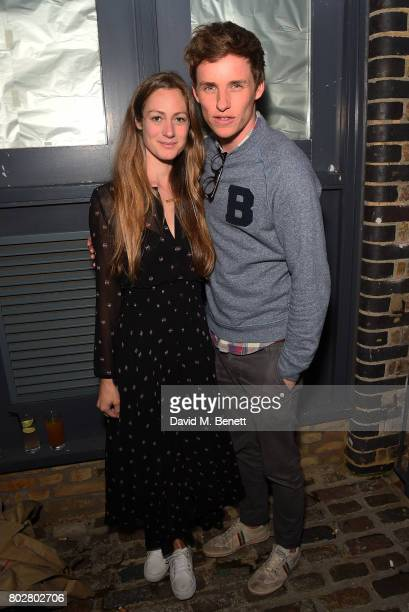 Eddie Redmayne and Hannah Bagshawe attend The Art Of Curating Fashion with Andrew Bolton presented by Sarabande The Lee Alexander McQueen Foundation...