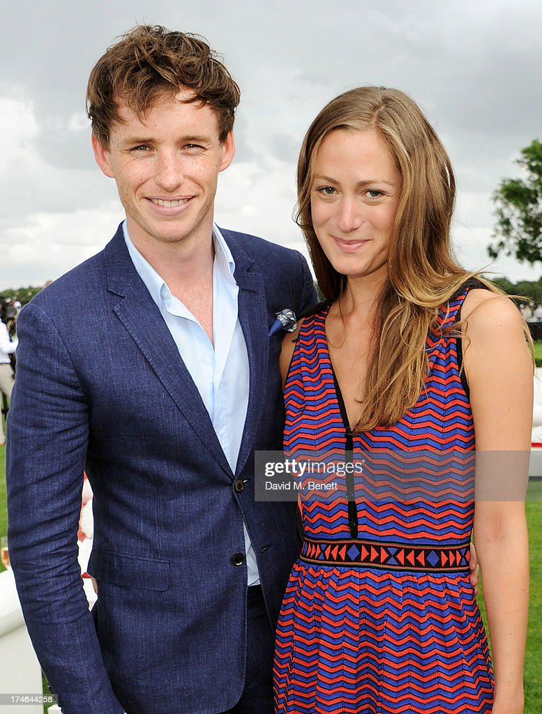 Eddie Redmayne (L) and Hannah Bagshawe attend the Audi International Polo at Guards Polo Club on July 28, 2013 in Egham, England.