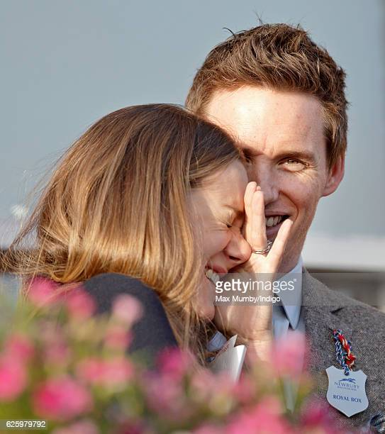 Eddie Redmayne and Hannah Bagshawe watch the racing as they attend the 60th Hennessy Gold Cup at Newbury Racecourse on November 26 2016 in Newbury...