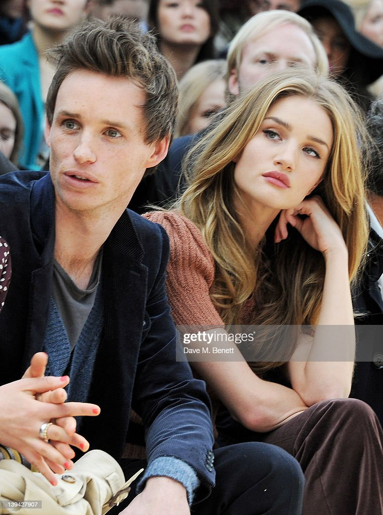 <a gi-track='captionPersonalityLinkClicked' href=/galleries/search?phrase=Eddie+Redmayne&family=editorial&specificpeople=2554844 ng-click='$event.stopPropagation()'>Eddie Redmayne</a> (L) and <a gi-track='captionPersonalityLinkClicked' href=/galleries/search?phrase=Rosie+Huntington-Whiteley&family=editorial&specificpeople=2244343 ng-click='$event.stopPropagation()'>Rosie Huntington-Whiteley</a> attend the Burberry Autumn Winter 2012 Womenswear Front Row during London Fashion Week at Kensington Gardens on February 20, 2012 in London, England.