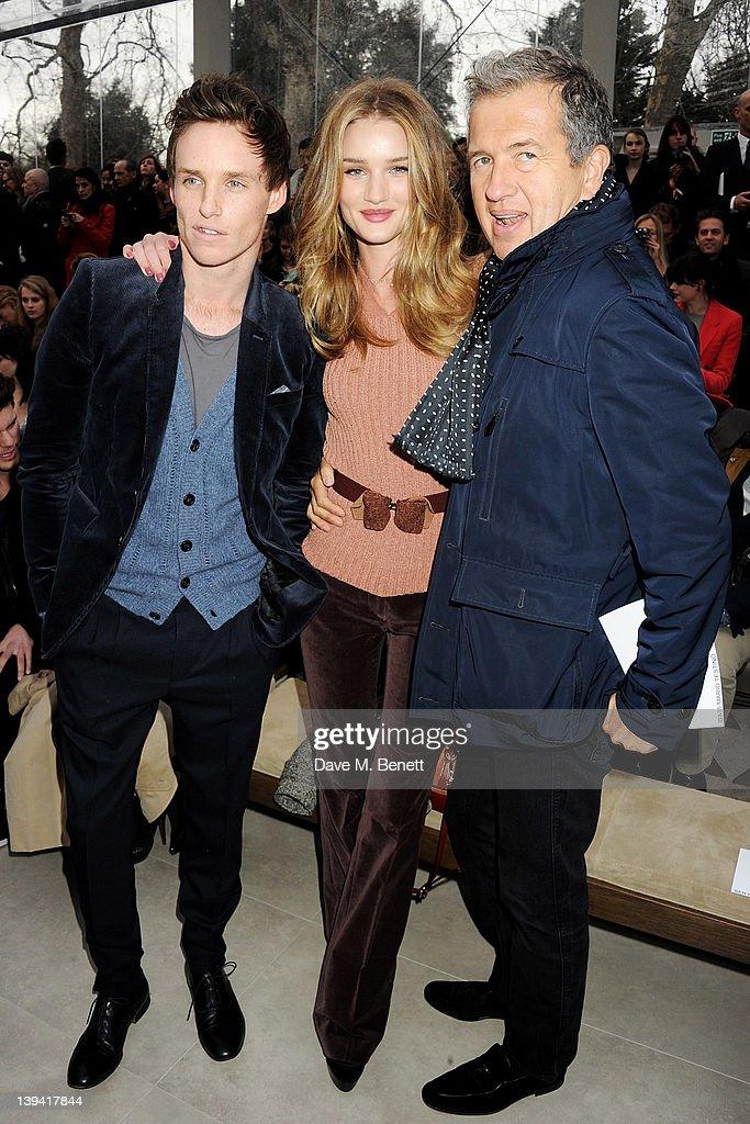 Eddie Redmayne, Rosie Huntington Whiteley and Mario Testino attend the Burberry Autumn Winter 2012 Womenswear Front Row during London Fashion Week at Kensington Gardens on February 20, 2012 in London, England.