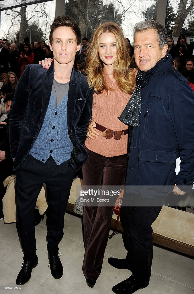 Eddie Redmayne, Rosie Huntington-Whiteley and Mario Testino attend the Burberry Autumn Winter 2012 Womenswear Front Row during London Fashion Week at Kensington Gardens on February 20, 2012 in London, England.