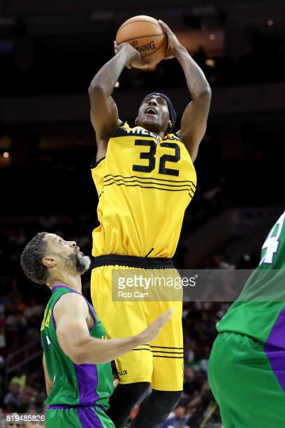 Eddie Robinson of Killer 3s shoots against Mahmoud AbdulRauf of the 3 Headed Monsters during week four of the BIG3 three on three basketball league...