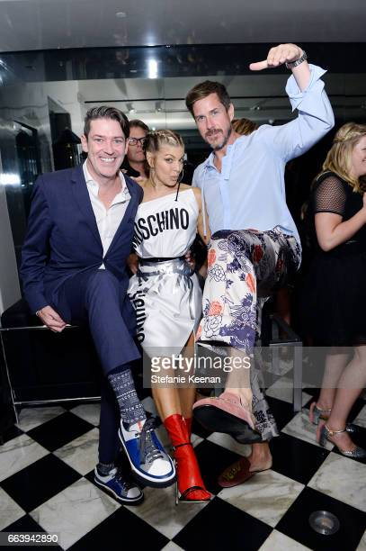 Eddie Roche Fergie and Mark Tevis attend The Daily Front Row and REVOLVE FLA after party at Mr Chow hosted by Mert Alas on April 2 2017 in Los...