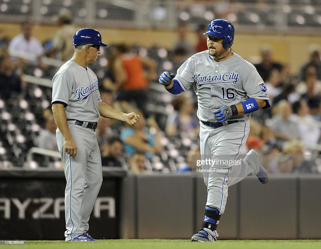 Eddie Rodriguez #14 of the Kansas City Royals congratulates <a gi-track='captionPersonalityLinkClicked' href=/galleries/search?phrase=Billy+Butler&family=editorial&specificpeople=759092 ng-click='$event.stopPropagation()'>Billy Butler</a> #16 as Butler rounds the bases after hitting a solo home run during the ninth inning of the game against the Minnesota Twins on August 27, 2013 at Target Field in Minneapolis, Minnesota. The Royals defeated the Twins 6-1.