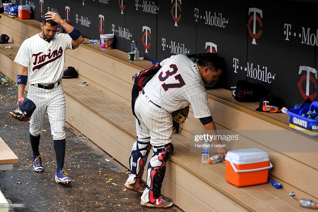 Eddie Rosario #20 and Juan Centeno #37 of the Minnesota Twins reacts in the dugout after a loss of the game against the Baltimore Orioles on May 11, 2016 at Target Field in Minneapolis, Minnesota. The Orioles defeated the Twins 9-2.