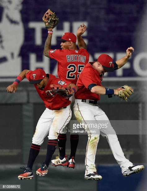 Eddie Rosario Byron Buxton and Max Kepler of the Minnesota Twins celebrates winning the game against the Baltimore Orioles on July 7 2017 at Target...