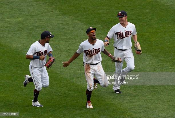 Eddie Rosario Byron Buxton and Max Kepler of the Minnesota Twins celebrating winning against the Texas Rangers after the game on August 6 2017 at...