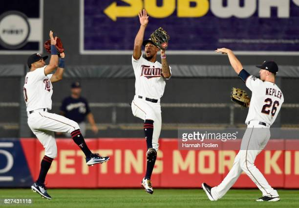 Eddie Rosario Byron Buxton and Max Kepler of the Minnesota Twins celebrates winning against the Milwaukee Brewers after the game on August 7 2017 at...