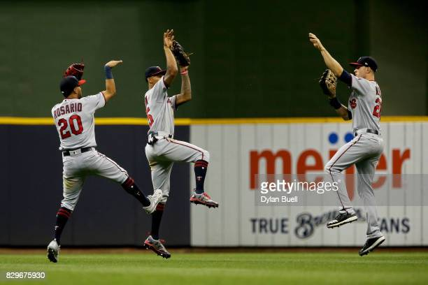 Eddie Rosario Byron Buxton and Max Kepler of the Minnesota Twins celebrate after beating the Milwaukee Brewers 72 at Miller Park on August 10 2017 in...