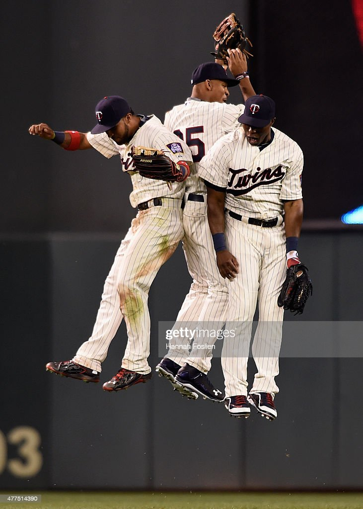Eddie Rosario #20, Byron Buxton #25, and Torii Hunter #48 of the Minnesota Twins celebrate a win of the game against the St. Louis Cardinals on June 17, 2015 at Target Field in Minneapolis, Minnesota. The Twins defeated the Cardinals 3-1.