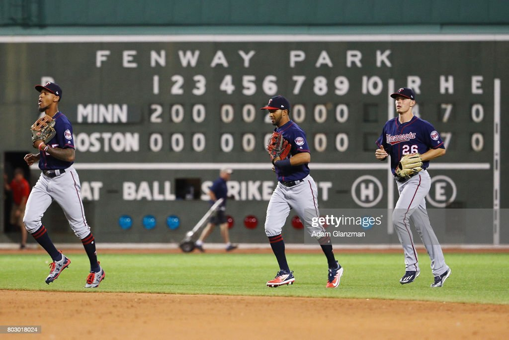 Eddie Rosario #20, Max Kepler #26 and Robbie Grossman #36 of the Minnesota Twins run off the field after their victory over the Boston Red Sox at Fenway Park on June 28, 2017 in Boston, Massachusetts.