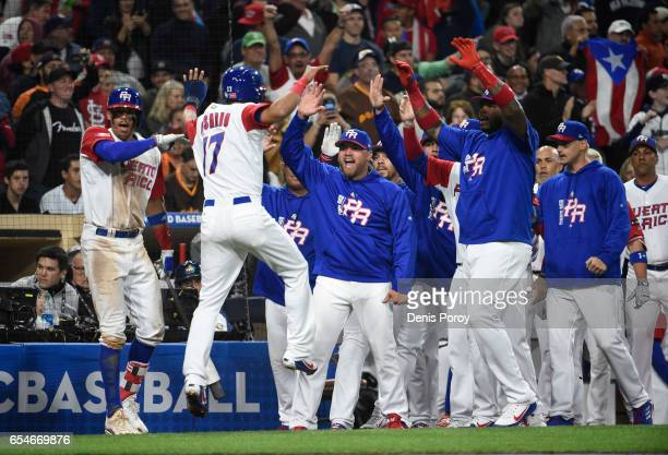 Eddie Rosario of Puerto Rico is congratulated after scoring during the sixth inning of the World Baseball Classic Pool F Game Four between the United...