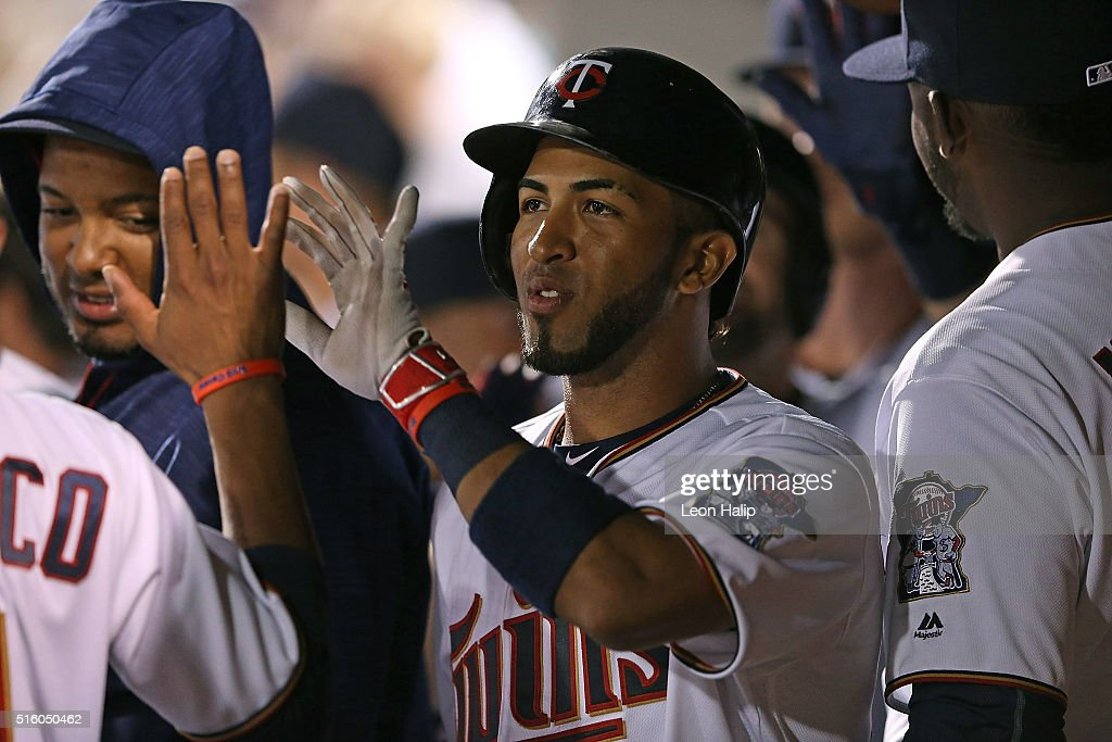 Eddie Rosario #20 of the Minnesota Twins celebrates in the dugout with his teammates after hitting a solo home run in the fifth inning of the Spring Training Game against the Boston Red Sox on March 16, 2016 at CenturyLink Sports Complex and Hammond Stadium, Fort Myers, Florida.