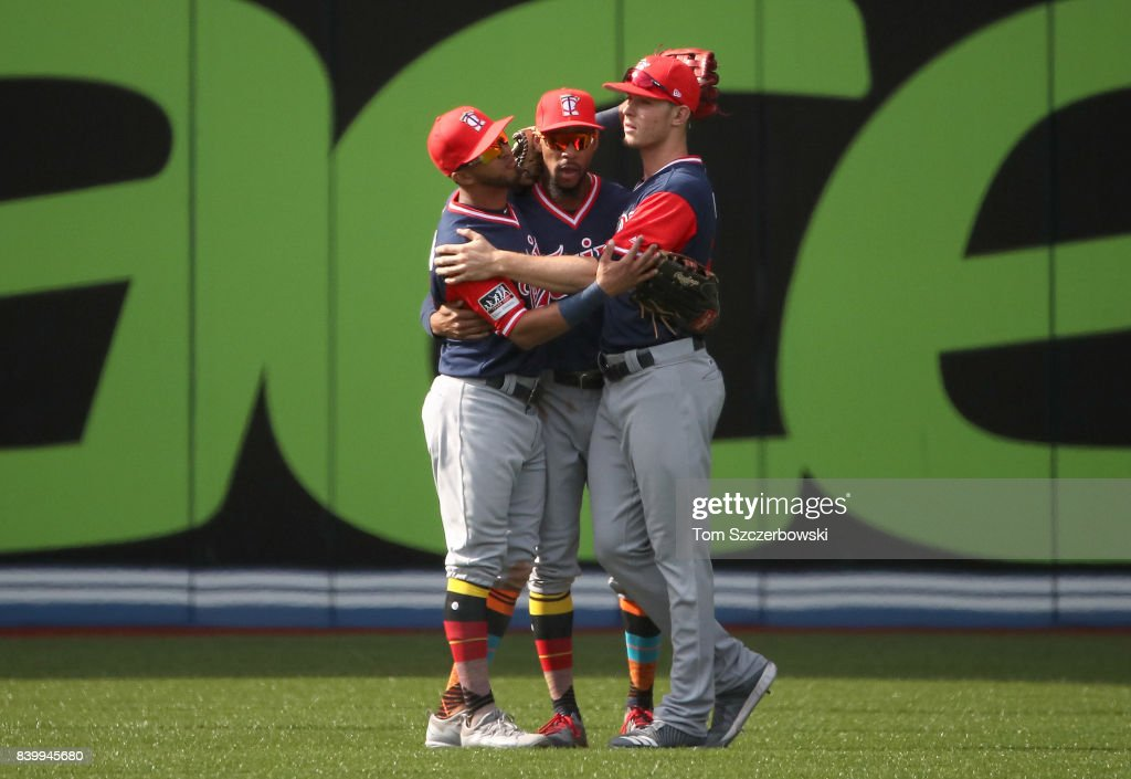 Eddie Rosario #20 of the Minnesota Twins celebrates their victory with Byron Buxton #25 and Max Kepler #26 during MLB game action against the Toronto Blue Jays at Rogers Centre on August 27, 2017 in Toronto, Canada.