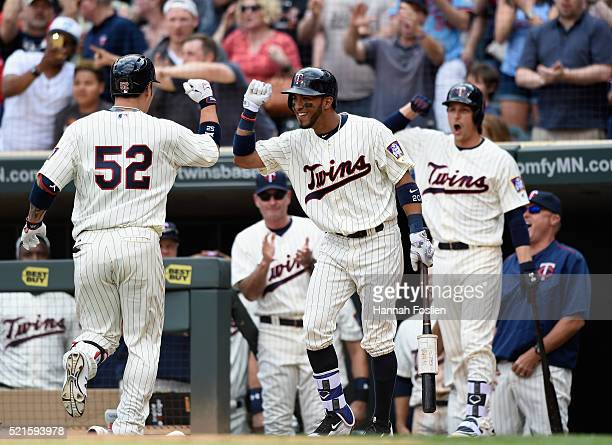 Eddie Rosario of the Minnesota Twins congratulates teammate Byung Ho Park on a solo home run against the Los Angeles Angels of Anaheim as manager...