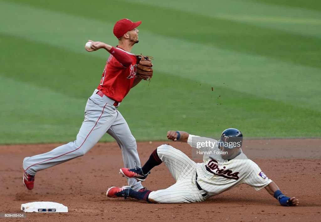 Eddie Rosario #20 of the Minnesota Twins is out at second base as Andrelton Simmons #2 of the Los Angeles Angels of Anaheim attempts to turns a double play during the second inning of the game on July 5, 2017 at Target Field in Minneapolis, Minnesota.