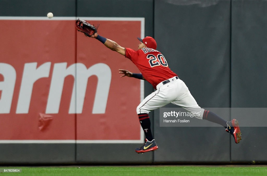 Eddie Rosario #20 of the Minnesota Twins is unable to reach an RBI double by Russell Martin #55 of the Toronto Blue Jays in right field during the seventh inning of the game on September 15, 2017 at Target Field in Minneapolis, Minnesota. The Blue Jays defeated the Twins 4-3.