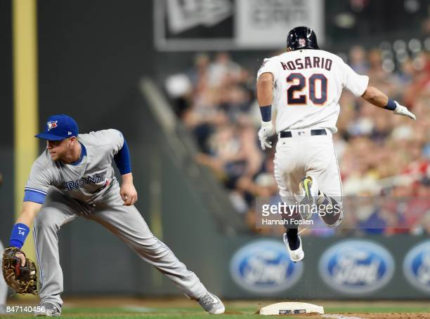 Eddie Rosario of the Minnesota Twins reaches first base as Justin Smoak of the Toronto Blue Jays fields the ball during the fourth inning of the game...