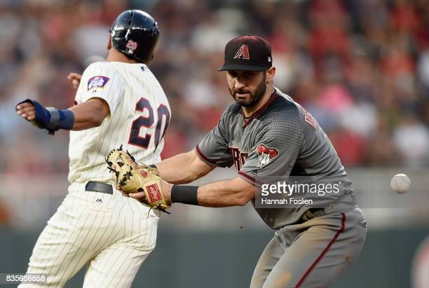 Eddie Rosario of the Minnesota Twins runs safely to second base as Daniel Descalso of the Arizona Diamondbacks is unable to field the ball during the...