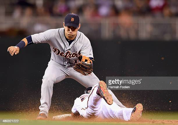 Eddie Rosario of the Minnesota Twins steals second base against Jose Iglesias of the Detroit Tigers during the ninth inning of the game on July 10...