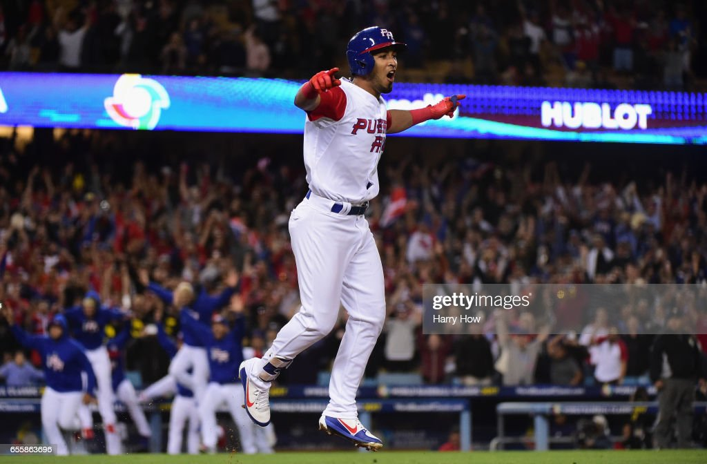Eddie Rosario #17 of the Puerto Rico celebrates their 4-3 win over team Netherlands in an 11-inning Game 1 of the Championship Round of the 2017 World Baseball Classic at Dodger Stadium on March 20, 2017 in Los Angeles, California. Puerto Rico won 4-3 in the 11th inning.
