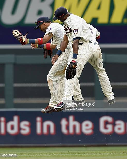 Eddie Rosario Torii Hunter and Aaron Hicks of the Minnesota Twins celebrate a win of the game against the Detroit Tigers on July 11 2015 at Target...