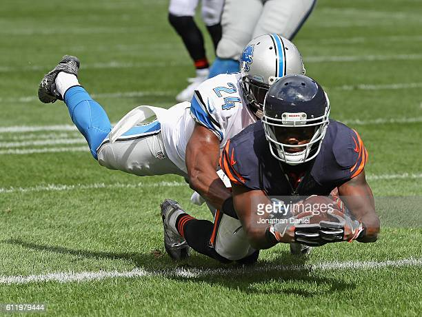 Eddie Royal of the Chicago Bears falls into the end zone to score a touchdwon dragging Nevin Lawson of the Detroit Lions with him at Soldier Field on...