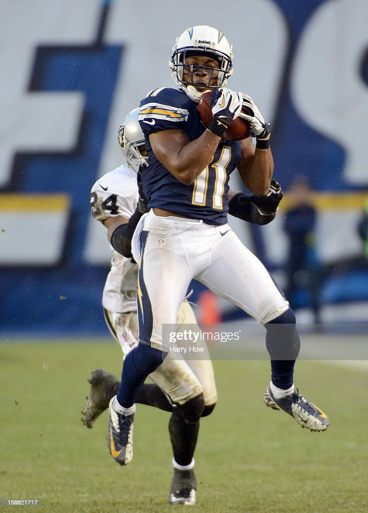 <a gi-track='captionPersonalityLinkClicked' href=/galleries/search?phrase=Eddie+Royal&family=editorial&specificpeople=2132149 ng-click='$event.stopPropagation()'>Eddie Royal</a> #11 of the San Diego Chargers makes a catch for a first down in front of <a gi-track='captionPersonalityLinkClicked' href=/galleries/search?phrase=Michael+Huff&family=editorial&specificpeople=648298 ng-click='$event.stopPropagation()'>Michael Huff</a> #24 of the Oakland Raiders during a 24-21 win at Qualcomm Stadium on December 30, 2012 in San Diego, California.