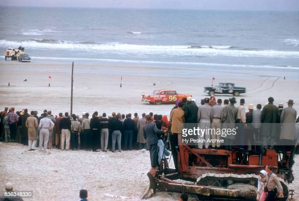 Eddie Skinner in the Oldsmobile car and Darvin Randahl in the Ford car race along the beach during the Daytona Beach and Road Course on February 26...