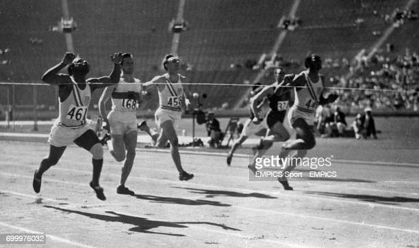 Eddie Tolan the black American runner wins the 200metre event in the record time of 2112 smashing the former Olympic record of 2104 seconds here...
