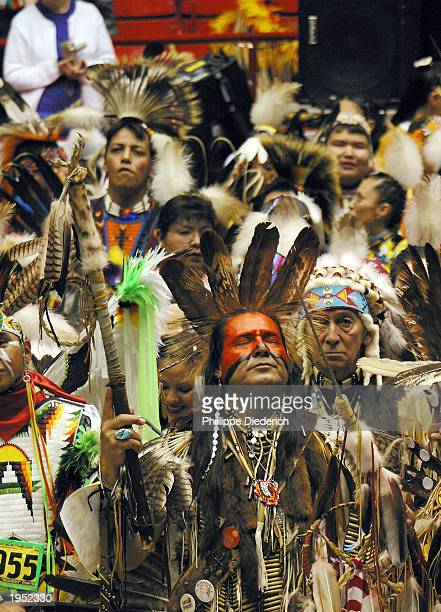 Eddie Two Clouds a Mescalero Apache Indian prays at the 20th annual Gathering Of Nations PowWow April 25 2003 in Albuquerque New Mexico The threeday...