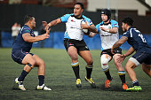 Eddie Uele of Grammar TEC fends during the match between College Rifles and Grammar TEC at College Rifles on July 23 2016 in Auckland New Zealand
