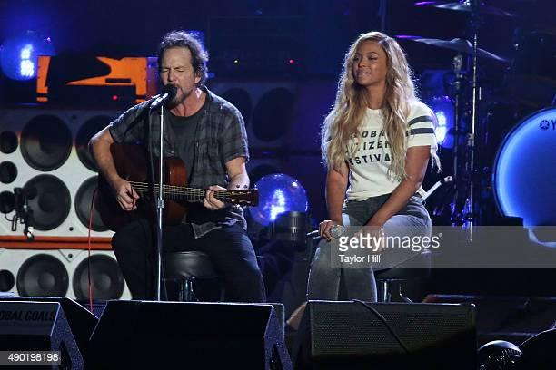 Eddie Vedder and Beyonce Knowles perform 'Redemption Song' during the 2015 Global Citizen Festival at Central Park on September 26 2015 in New York...