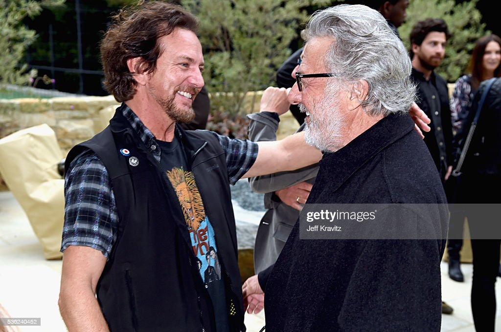 <a gi-track='captionPersonalityLinkClicked' href=/galleries/search?phrase=Eddie+Vedder&family=editorial&specificpeople=208156 ng-click='$event.stopPropagation()'>Eddie Vedder</a> and <a gi-track='captionPersonalityLinkClicked' href=/galleries/search?phrase=Dustin+Hoffman&family=editorial&specificpeople=171356 ng-click='$event.stopPropagation()'>Dustin Hoffman</a> attend WHO Cares About The Next Generation at a private residence on May 31, 2016 in Pacific Palisades City.